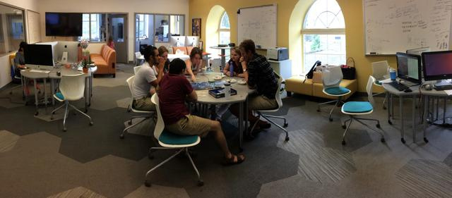 The students in the photo here are taking a break by playing a board game in the research area.